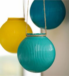 Globes - http://apps.facebook.com/lowesideaexchange/?id=858  Description: Check out Lowe's Idea Exchange today to see more inspiring projects.  Keep your patio party going after dark by hanging these glass lanterns. They add color to an outdoor living area by day and give a friendly glow at night.