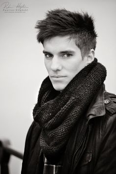 Hair:  Like the edgy look of the current hairstyle with the super short sides and the long top.
