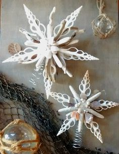 Have a seaside holiday! These hand made Christmas Tree Toppers are made of white sea stars, sliced white spindle shells, and sea urchin spines, and are jeweled with pieces of abalone, pearls, and tiny