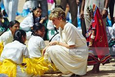 Princess Diana the Princess of Wales bends down to chat with Indian dancers who welcomed her on her arrival  in Hyderabad, India in February of 1992. (Photo by Anwar Hussein/Getty Images)
