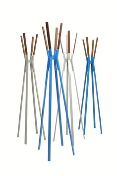 Splash Coat Rack - Powder-coated steel and solid walnut stand at the ready to relieve you of jackets, hats, scarves and bags in style. Dress it up or keep it naked. Either way it remains easy on the eyes. Who says utility can't be attractive? Available in bright blue, complete yellow, putty grey, humble red, white, and olive.