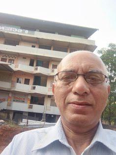 Advocate Jayaprakash Mallay in front of the college at Manjeri