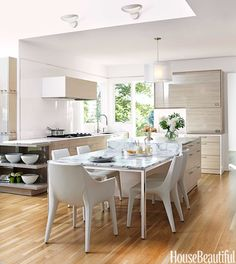 New spin on the traditional kitchen table, an extended island to creates an inviting place for the whole family to hang out.