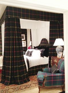 .Wow! A bedroom for your castle! The plaid is so bold & yet so right too. Great treatment- great room.