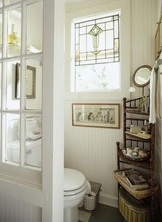 Love this little divider using a window.  The etegere is pretty also, like the way the white sets off the wood tones.  The Blessed Hearth