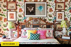 It's the lustrous colors of this wallpaper paired with framed prints that makes me smile. Color!