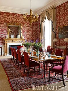 "The formal dining space features Farrow & Ball's ornate ""St. Antoine"" damask wallpaper. - Photo: Francis Hammond / Design: Mark Gillette"