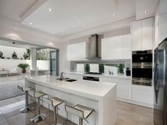 Straight line kitchen with island, low level slimline window, rangehood over window | realestate.com.au/home-ideas