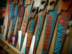 Clever hand painted saws with unique lettering, colors and style