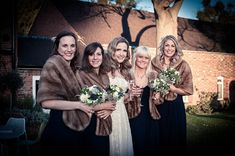 Faux fur wraps keep bridesmaids warm. Reem Acra for a Fashionable Bride and her Stoke Place Wedding. Photography by www.contemporary-wedding.com