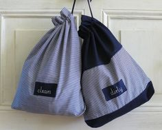 Be prepared for travel!  Set of two navy blue and thin stripes fabric pouches with hand embroidered clean and dirty on labels. Bags will be useful during