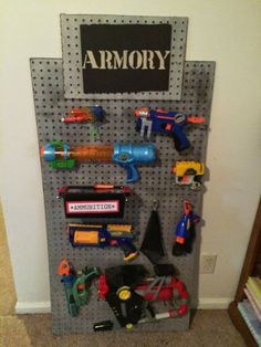 spy party armory on pegboard. also good for a toy room, place to store Nerf guns.