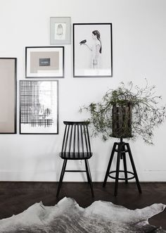 Blog favourites as of late. Composition of elements; bright white wall, black furniture, gallery prints