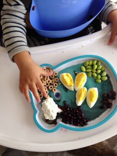 #Breakfast @ 15 months old: #Organic #wholewheat #cereal, organic #eggs, home-grown #pomegranate seeds, organic #raisins, organic #edamame, organic cottage #cheese
