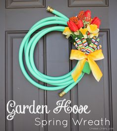 Upcycled garden hose to #DIYWreath from Create Craft Love, featured @totgreencrafts