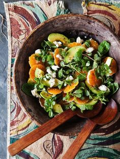 1/2 cup fresh tangerine juice 1 jalapeño 1 small shallot, finely chopped 2 tablespoons white wine vinegar Kosher salt, freshly ground pepper 1/4 cup vegetable oil 2 tablespoons extra-virgin olive oil 2 avocados, sliced 4 tangerines or clementines, peeled, sliced into rounds 6 cups purslane, arugula, or watercress, thick stems trimmed 1/2 cup fresh mint leaves 2 ounces feta, crumbled (about 1/3 cup)