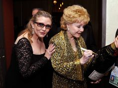 Debbie Reynolds and Carrie Fisher backstage during TNT's 21st Annual Screen Actors Guild Awards at The Shrine Auditorium on January 25, 2015 in Los Angeles, California.