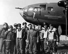 "Americana - The crew of the B-17 ""Memphis Belle"" back from its 25th operational mission. All of the crew hold the Distinguished Flying Cross and the Air Medal. It all started with this Boeing B-17 Flying Fortress. In all of its missions, there was only one casualty, a leg wound to the tail gunner, June 1943."