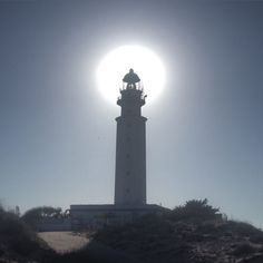 The sun behind Trafalgar light house, Costa de la Luz