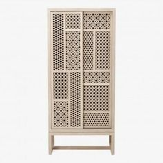 crafted with the simple elegance and warmth of fine woods, the teak armoire conjures visions of Moroccan getaways. finished with a natural white varnish, each piece is embellished with intricate tessellations and an asymmetric design that draws the eye to the beauty of the unusual.