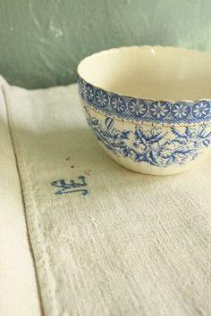 vintage bowl on vintage towel - love the scalloped edge on bowl