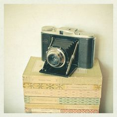Original fine art photograph featuring an old camera on a stack of vintage books. Title: Memories Paper Size: 8 x (This print includes a white border for easier framing). An unframed print, titled and signed on the front by Cassia Beck. Passion Photography, Nature Photography Tips, Photography Camera, Photography Hashtags, Pregnancy Photography, Photography Classes, Photography Backdrops, Landscape Photography, Portrait Photography