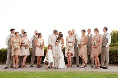 Different bridesmaid dresses in tan with groomsmen in darker tan suits. Like!
