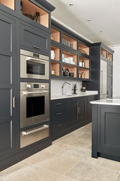 Dark Grey Shaker Style Kitchen The striking dark grey finish looks both luxurious and contemporary and works wonderfully with the white worktops. The strategically placed lighting inside the shelves gives the room a warm, inviting glow after dark. Home Decor Kitchen, Shaker Style Kitchens, Dark Grey Kitchen, Grey Kitchen Designs, Kitchen Remodel, Kitchen Styling, Dark Kitchen, Kitchen Renovation, Kitchen Design