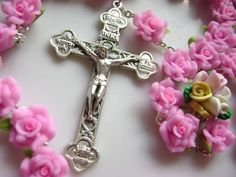 This is a powerful message from Jesus. He appears with a large Rosary draped across His chest and back, with a large silver crucifix hanging at His hip. Ceramic Beads, Clay Beads, Silver Roses, Pink Roses, Catholic Crucifix, Religious Symbols, Beaded Cross, First Holy Communion, Names Of Jesus