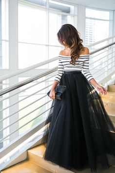 Inspired by a vintage Parisian vibe, a tulle skirt and stripes complement each other well and embody a clean, classic, and feminine look. #Style #Fashion