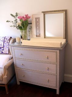 IKEA Hackers: grasscloth & nailheads.  Want to do this to our dressers!
