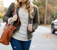 great layers, textured sweater under a rough camo green blazer, brown bag, just needs a substantial statement necklace