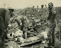 """Medic dressing wounded officer -- Flanders Fields. """" In Flanders' field row on row..."""" poem written by a Canadian soldier  WWl.  Why we wear poppies every  Nov. 11th"""