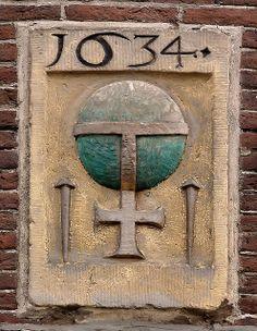 Herengracht 419 - Gevelsteen met een omgekeerde Rijksappel