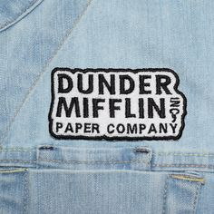 Are you a HUGE fan of The Office? Are you looking for the perfect give for a HUGE fan of The Office? Look no further! This Dunder Mifflin Paper Company patch is the perfect accessory to show your love for the hilarious documentary-style show!! The patch is machine embroidered upon the receipt of your order and has an iron on backing, making it quick an easy to apply to your T-shirt, backpack, levi jacket, or anywhere you can dream of--instructions below! The patch is a convenient small size…