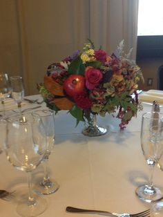 elegant pedestal centerpiece with rich tones of red and purple. Miniature and full-size pomegranates were a perfect addition for this fall wedding <3