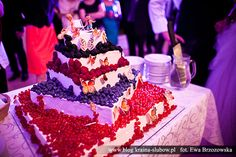 Wedding cake with forest fruits.