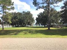 This GORGEOUS 1.03 acre LAKE FRONT PROPERTY is for sale in St. Cloud, FL Vacant Land, Acre, Golf Courses, Sidewalk, Lake Front, St Cloud, Clouds, Side Walkway, Walkway