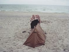 Three ladys under the blanket, after swim on the sea
