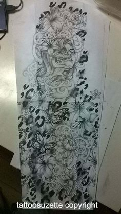 Flower and leopard print tattoo (full sleeve) Don't really dig the skull/face but great concept