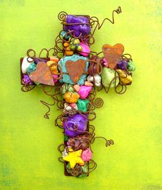 Hey, I found this really awesome Etsy listing at http://www.etsy.com/listing/72052411/wire-wrapped-rusty-wall-cross-with