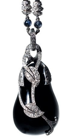 """CARTIER Art Deco Onyx and Diamond """"Aubergine"""" Pendant.  Diamond-mounted platinum leaf vine onyx """"aubergine"""" pendant, mounted with sapphire and diamond accents on black cord.  By Cartier, New York, circa 1930.  Pendant length (including bail): 1-3/4 inches."""