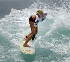 Bethany Hamilton.  This picture is very inspiring to me because she showed that no matter what, she didn't give up on what she loved to do, surfing. ANYTHING is possible. She is such a strong girl it was amazing to see how she overcame this shark attack and really inspired others.