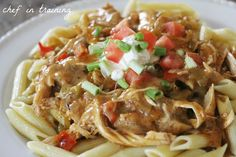 Chicken Enchilada Pasta... this meal is amazing! Pasta and Mexican food combine to make one incredible dinner!