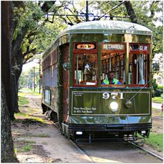 New Orleans Streetcar #971 coming through the Oaks on St. Charles Avenue (image by Eric Bouler)