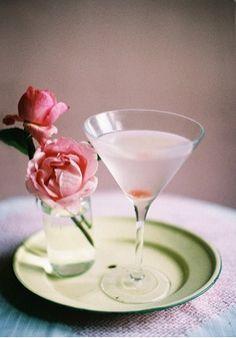 Rosetini (Rose Martini): Ice, 3 ounces vodka, 1 ounce rose syrup, dash of Angostura bitters, organic rose petals