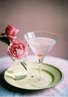 Rosetini (Rose Martini): Ice, 3 ounces vodka, 1 ounce rose syrup, dash of Angostura bitters, organic rose petals