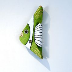This reclaimed wood fish was handmade by Marc Deloach from spruce salvaged in Vermont. I, Christine Schultz, hand painted it in olive green and white acrylics. Its the perfect gift for a friend, a relative, or yourself. No two are the same. This listing is for one.  Dimensions: 12 tall x 5 wide x 2 thick.  Special Features: This green and white fish has a gold eye and lips. The tail is white with black stripes. The reclaimed spruce wood is slightly textured but smooth to the touch. I painted…