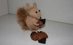 """8 ply (DK) or 10 ply (worsted) yard are fine for this little guy.This little squirrel is busy collecting acorns.He is knitted on 2 needles. Uses 8 ply (worsted) yarn. A great project for a beginner. He stands at about 15cm (6"""") to the top of his ears."""