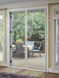 Outward opening french doors with retractable screens.